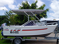 Boat with awning fitted
