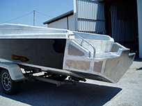 Boat with fabricated step