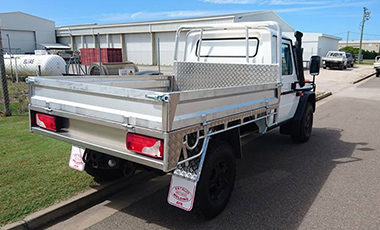 Mercedes truck with drop side tray